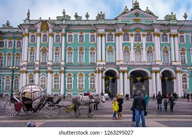 ST. PETERSBURG, RUSSIA - OCTOBER 8, 2017: Tourist taking pictures with carriage at the Palace Square outside the historical Winter Palace, St Petersburg, Russia