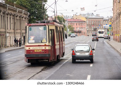ST. PETERSBURG, RUSSIA - OCTOBER 8, 2017: A tram and a car on the road of St. Petersburg, Russia. Editorial Use Only.
