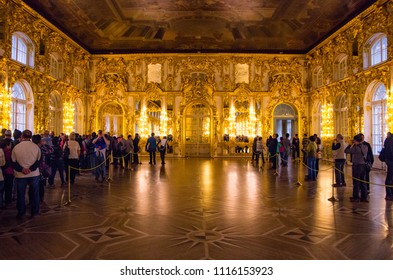 ST PETERSBURG, RUSSIA - OCTOBER 9, 2017: Tourists queuing up for guided tour inside the luxurious Hall of Mirrors at St. Catherine's Palace in St Petersburg, Russia