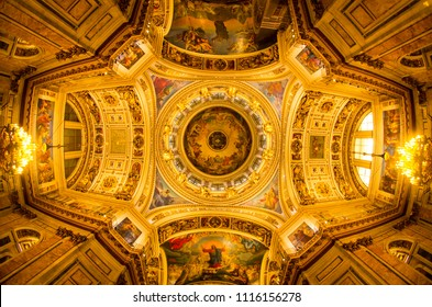 ST PETERSBURG, RUSSIA - OCTOBER 9, 2017: The ceiling wall-painting with a dove at the center at one of the world's largest Dome of the St. Issac's Cathedral in St. Petersburg
