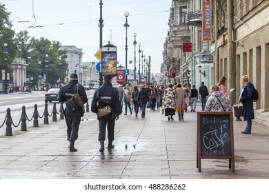 ST. PETERSBURG, RUSSIA, on August 20, 2016. Urban view. Police officers patrol Nevsky Avenue
