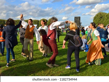 ST. PETERSBURG, RUSSIA - SEPT 15, 2018: 281 Birthday of Vasileostrovsky district. Dancers in national clothes learn to dance all visitors in park