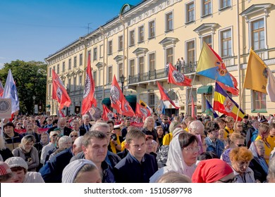 ST PETERSBURG, RUSSIA - September 12, 2019: Religious procession, a crowd of believing Christians carry icons and flags on Nevsky Prospekt in St. Petersburg
