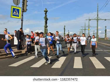 """ST. PETERSBURG, RUSSIA - SEPTEMBER 15, 2018: Participants of """"Cross of Nation - 2018"""" mass running event in St. Petersburg. Athletes and students"""
