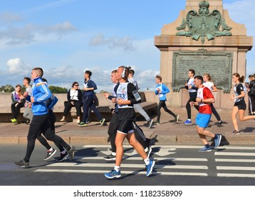 """ST. PETERSBURG, RUSSIA - SEPTEMBER 15, 2018: Participants of """"Cross of Nation - 2018"""" mass running event in St. Petersburg. Young athletes"""
