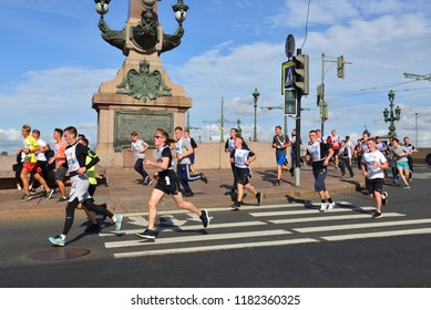 "ST. PETERSBURG, RUSSIA - SEPTEMBER 15, 2018: Participants of ""Cross of Nation - 2018"" mass running event in St. Petersburg. Runners"