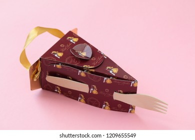 ST. PETERSBURG, RUSSIA - SEPTEMBER 25, 2018: Slice of Sacher torte in paper box. This chocolate cake was invented by Franz Sacher in 1832, and now December 5th is National Sachertorte Day in the US