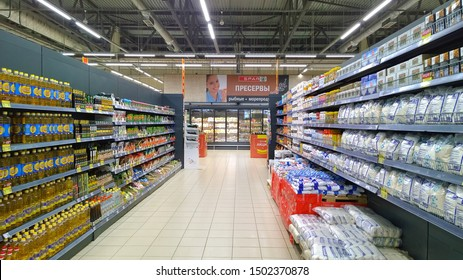 St. Petersburg, RUSSIA - September 4, 2019: Rows of shelves with fresh products in the Russian supermarket. Consumer goods, sugar, salt, sunflower and olive oil for customers.