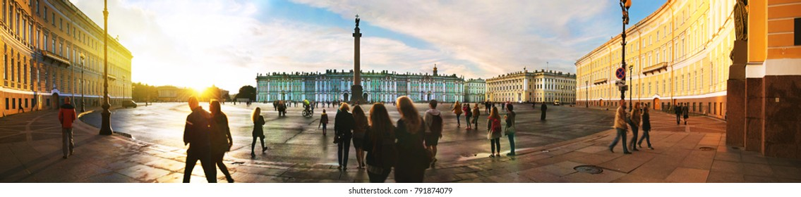 St Petersburg, Russia at sunset. Palace square in Saint Petersburg, Russia during the evening with cloudy sky crowded with people.