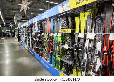 ST. PETERSBURG, RUSSIA-CIRCA DEC, 2018: Mountain ski and snowboard equipments, winter sport goods are on sale in Decathlon Russian store. Decathlon is a French sporting goods retailer