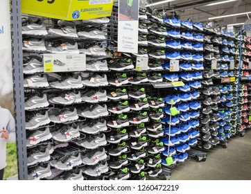 ST. PETERSBURG, RUSSIA-CIRCA DEC, 2018: Jogging and hiking shoes are on sale in Decathlon Russian store. Nobody. Decathlon is a French sporting goods retailer
