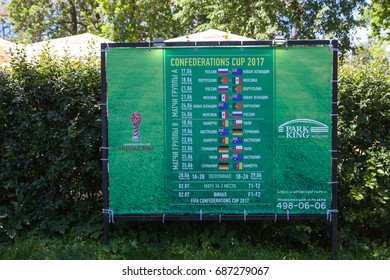 ST. PETERSBURG, RUSSIA-CIRCA JUN, 2017: Information boars with timetable of games of Confederation cup is in urban park. Confederation cup was held in summer of 2017