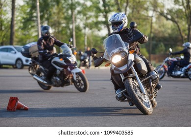 ST. PETERSBURG, RUSSIA-CIRCA MAY, 2018: Motorcyclists drive around cones on urban square. Free skill training as gymkhana for all riders
