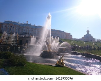 St. Petersburg, Russia-June 15, 2018: Grand Cascade of fountains and Sea canal in Peterhof Palace. Magnificent view of the Peterhof Palace in summer. Postcard Peterhof Palace on a Sunny day.A UNESCO