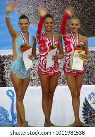 St. Petersburg, Russian Federation - August 17, 2013: Rhythmic Gymnastics World Cup Winners - Gold (middle) Margarita Mamun; Silver (left) Meletina Staniouta; Bronze (right) Yana Kudryavtseva