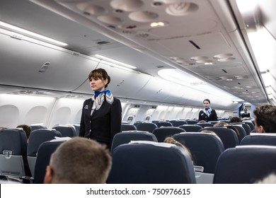 St. Petersburg, Russian Federation - October 16, 2017:  Stewardesses  in the cabin of the Boeing 737-800 passenger airplane instructs passengers on safety measures in the event of an emergency