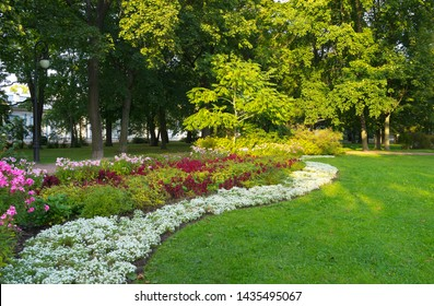 St. Petersburg summer afternoon. City park near the Smolny Cathedral with beautiful flower beds and green lawns. Natural garden background. City landscape. Comfortable urban environment