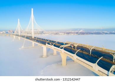 St. Petersburg in the winter. Russia. Highway. Panorama of Krestovsky Island. Neva River. Cable bridge Bridges of St. Petersburg. Auto roads in Russia. Saint Petersburg.