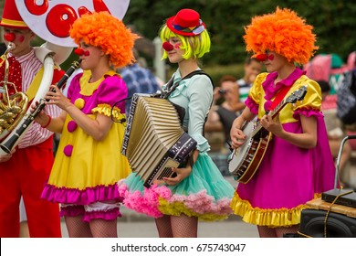 St. Petersburg-11.07.2017: Performance of clowns with musical instruments in the amusement park on Krestovsky Island