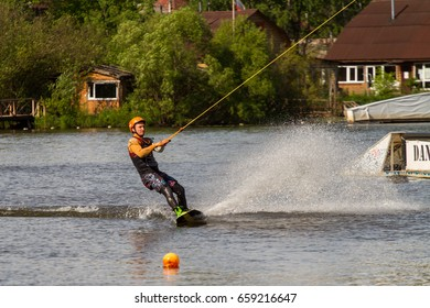 St. Petersburg-13.06.2017: the sportsman is surfing on an artificial wave