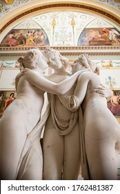 "ST. PETERSBURG/RUSSIA - SEPT. 7, 2019: Vertical orientation photo of Antonio Canova's marble statue ""The Three Graces."" The Neoclassical sculpture is located in the Hermitage Museum,"