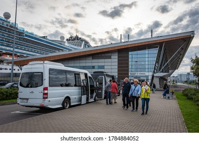 ST. PETERSBURG/RUSSIA - SEPT. 8, 2019: Photo of an Alla Tour bus with group of tourists at the cruise ship terminal on Vasilyevsky Island.