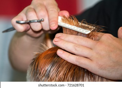St. Petersburg-September 24, 2017: the master hairdresser makes a model haircut to the client