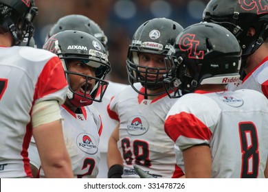 ST. POELTEN, AUSTRIA - JULY 26, 2014: QB Phillip Garcia (#2 Lions) talks to his team in the huddle during Silver Bowl XVII.