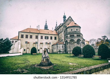 St. Procopius Basilica is a Romanesque-Gothic Christian church in Trebic, Czech republic. Religious architecture. Travel destination. Analog photo filter with scratches.