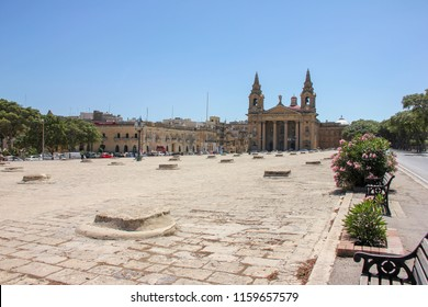 St. Publius' Square wity church and old Granaries in Floriana Malta in hot noon