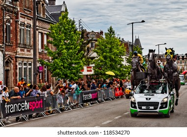 ST. QUENTIN, FRANCE,JUL 5 :PMU (Le Pari Mutuel Urbain) car during the passing of publicity caravan in Saint Quentin during the stage 5th of Le Tour de France on July 5 2012.