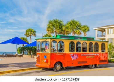 ST. SIMONS, GEORGIA - October 19, 2014: Since Old Town Trolley Tours began in the early '70s trolley tours have become a favorite of tourists in cities all over the country, including Simons Island