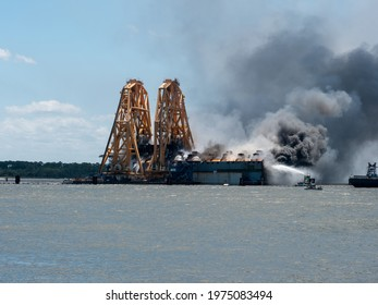 St Simons Island, GA USA - May 14 2021: Fire breaks out during demolition of Golden Ray cargo ship in the St. Simons Sound