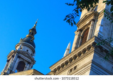 St. Stephen's Basilica largest church in Budapest, Hungary. Fragment of facade at sunny summer weather. Is one of the most beautiful and significant churches and touristic attractions of the country.