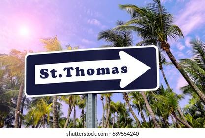 St Thomas arrow sign. Palm tree background.