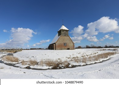 St Thomas a Becket Church, Fairfield, Romney Marsh, Kent, England surrounded by a blanket of snow