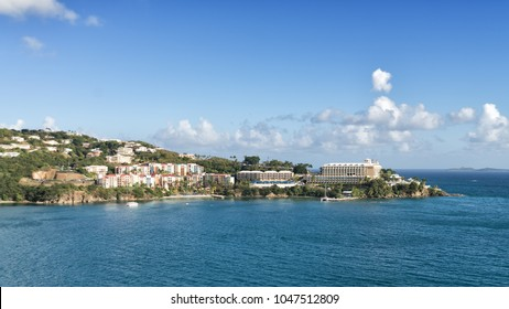 """ST. THOMAS, US VIRGIN ISLANDS - FEBRUARY 4, 2015: """"Marriott's Frenchman's Cove"""" and """"Frenchman's Reef & Morning Star Marriott Beach Resort"""" are popular tourist destinations in the Caribbean sea."""