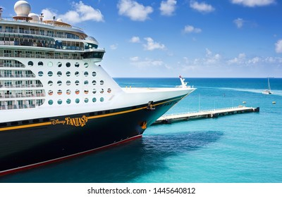 ST. THOMAS, US VIRGIN ISLANDS - March 27, 2019:  Cruise ship Disney Fantasy docked at St Thomas on sunny day.
