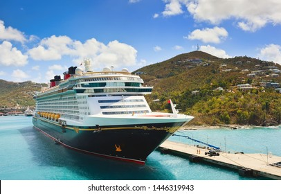 ST. THOMAS, US VIRGIN ISLANDS - March 27, 2019:  Cruise ship Disney Fantasy docked at St Thomas, on sunny day.