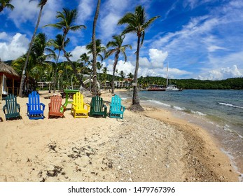 St. Thomas/USA-11/4/16: Colorful beach chairs, palm trees, sailboats tied up to the dock, and beautiful sand beach makes it a great tourist hang out in St. Thomas, US Virgin Islands.