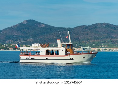 ST TROPEZ, FRANCE - OCTOBER 24, 2017: Sightseeing boat with tourists making a tour on the mediterranean sea