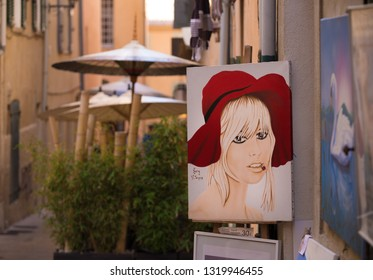 ST TROPEZ, FRANCE - OCTOBER 24, 2017: Painting of a woman face in the old town of St Tropez
