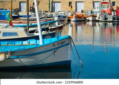ST TROPEZ, FRANCE - OCTOBER 24, 2017: fishing boats in the colorful harbor of St Tropez