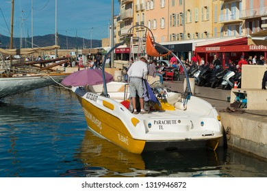 ST TROPEZ, FRANCE - OCTOBER 24, 2017: Quay of the famous old harbor of St Tropez on a sunny autumn day