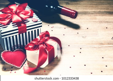 St Valentine's background with presents and red wine. Greeting card concept