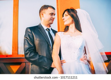 St. Valentine's Day. Bride and groom, love, friendship, relationship. Beautiful bride embrace looking at each other's eyes