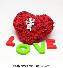 St. Valentine's Day.Red heart.Red thread.Fate.I love you.Cupid.Isolated white background.