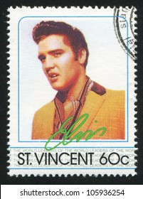 ST. VINCENT - CIRCA 1985: A stamp printed by St. Vincent, shows Elvis Presley, American Entertainer, circa 1985.