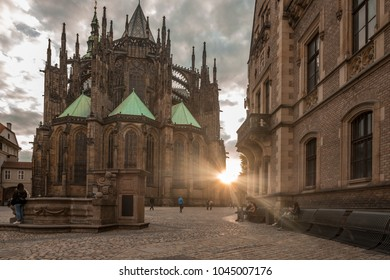 St. Vitus Cathedral in Prague Castle. The setting sun bursts from behind the cathedral