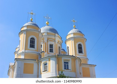 St. Vladimir's Orthodox Cathedral in Saint Petersburg, Russia. Neoclassical Architecture of Old Russian Church Building Exterior on Summer Day, Close Up Image of Church on Empty Blue Sky Background.